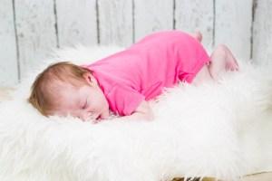 Little Hazel on a faux fur blanket