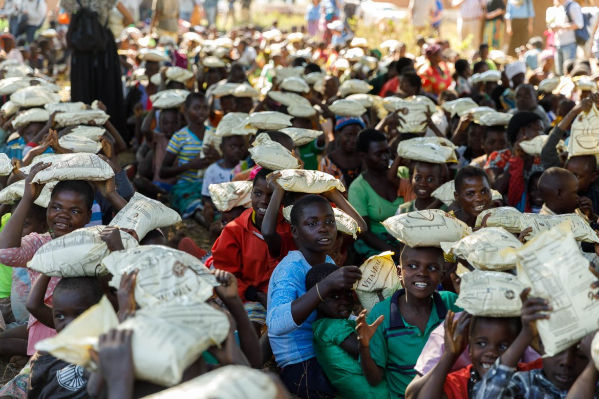 A group of Malawian children with bags of VitaMeal on their heads