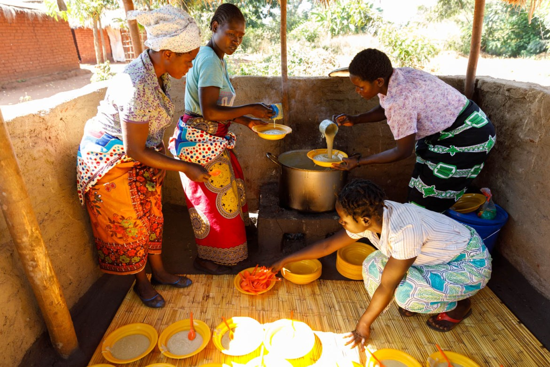 Local villagers prepare the Nourish the Children porridge