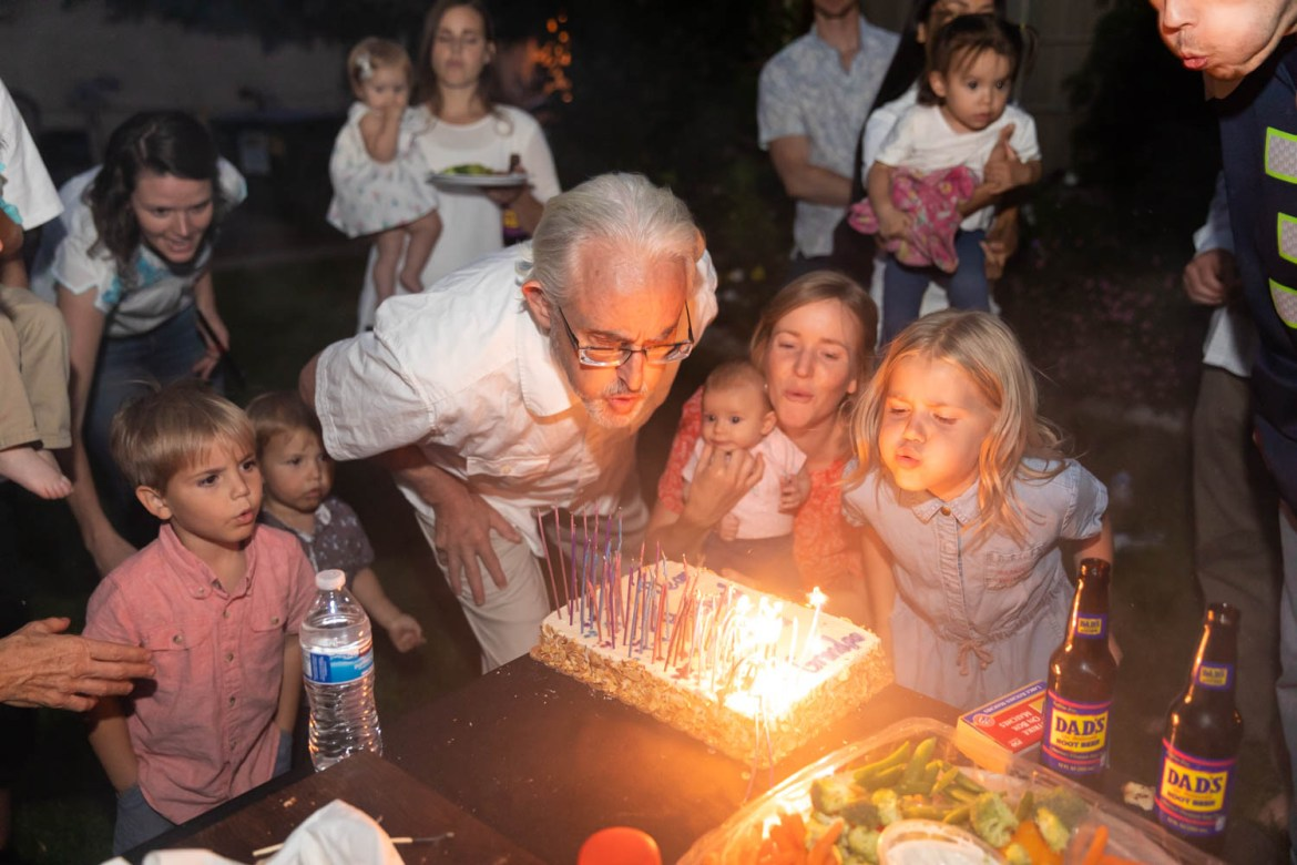 Blowing out the candles with the grandkid's help