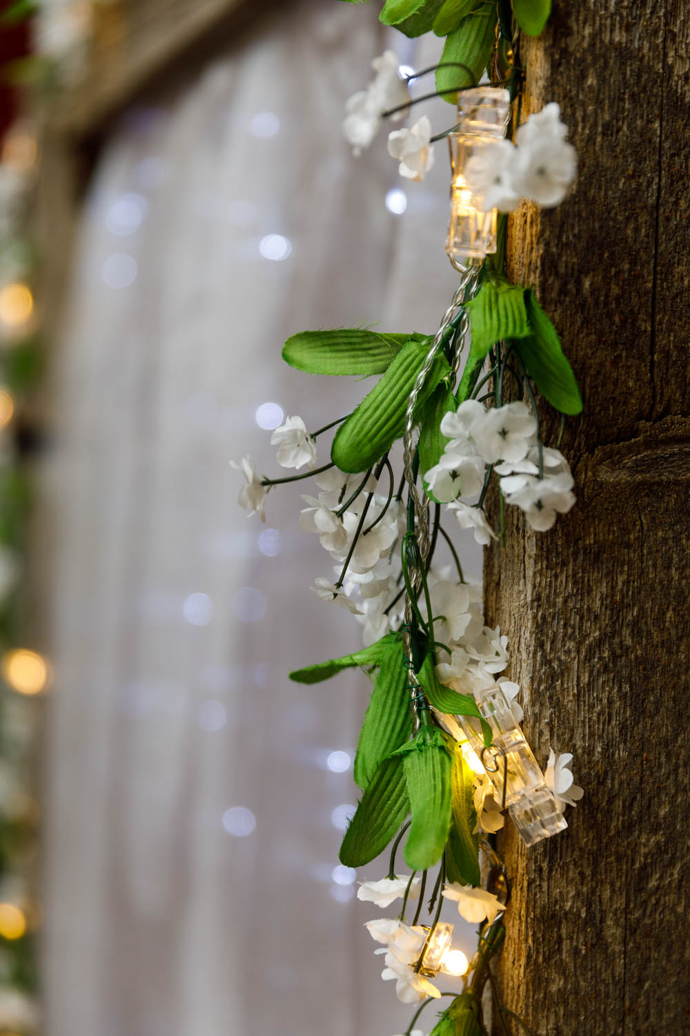 Wedding flowers and lights on the arch