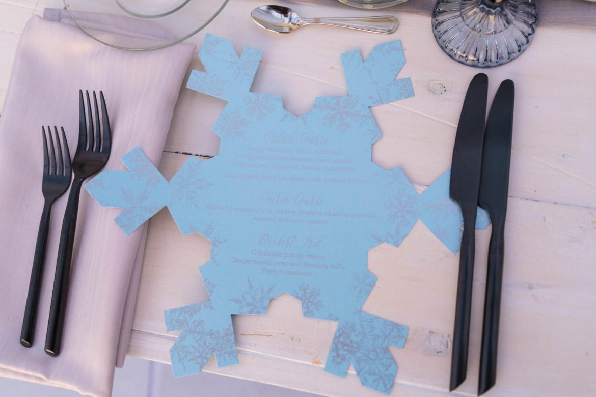 A silver and blue snowflake menu