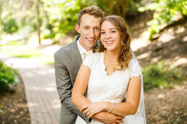Wedding couple pose for portrait