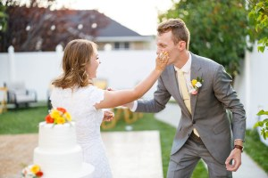 Bride smashes frosting on the groom's face