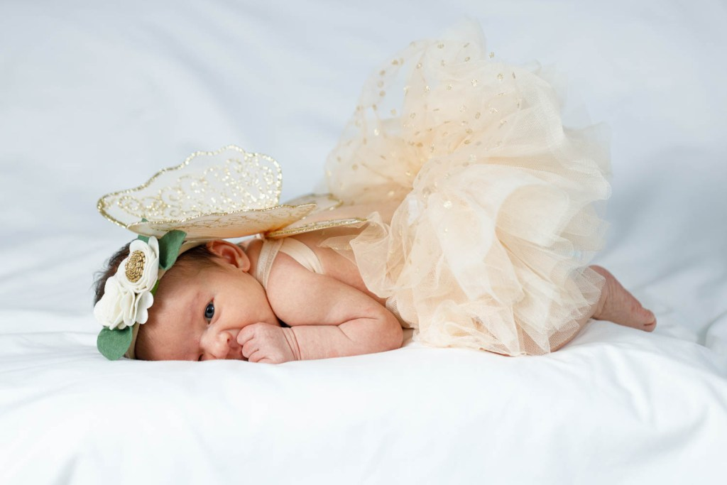 Baby Nora in a tutu with angel wings