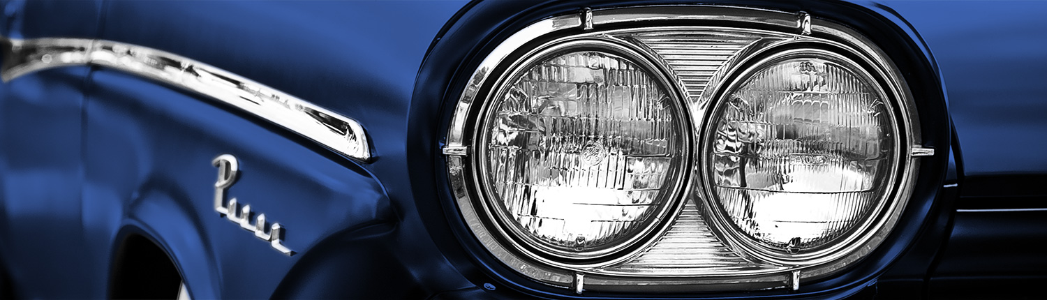 a photo of the lights on a vintage car.