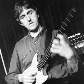 [ Picture of Allan Holdsworth playing his guitar]