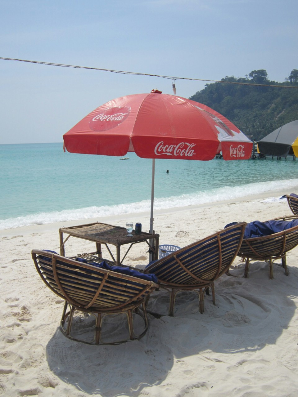 Beach chairs with umbrella for shade on the white sand Sok San beach, Koh Rong, Cambodia