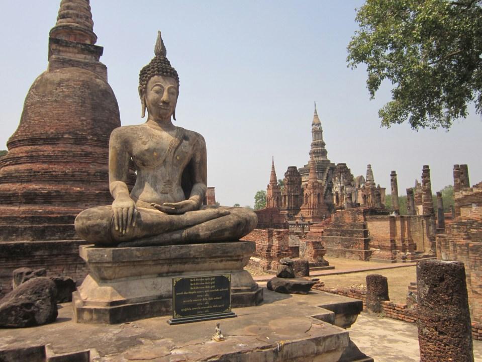 Buddha statue and ruins at Sukhothai Historical Park, Thailand
