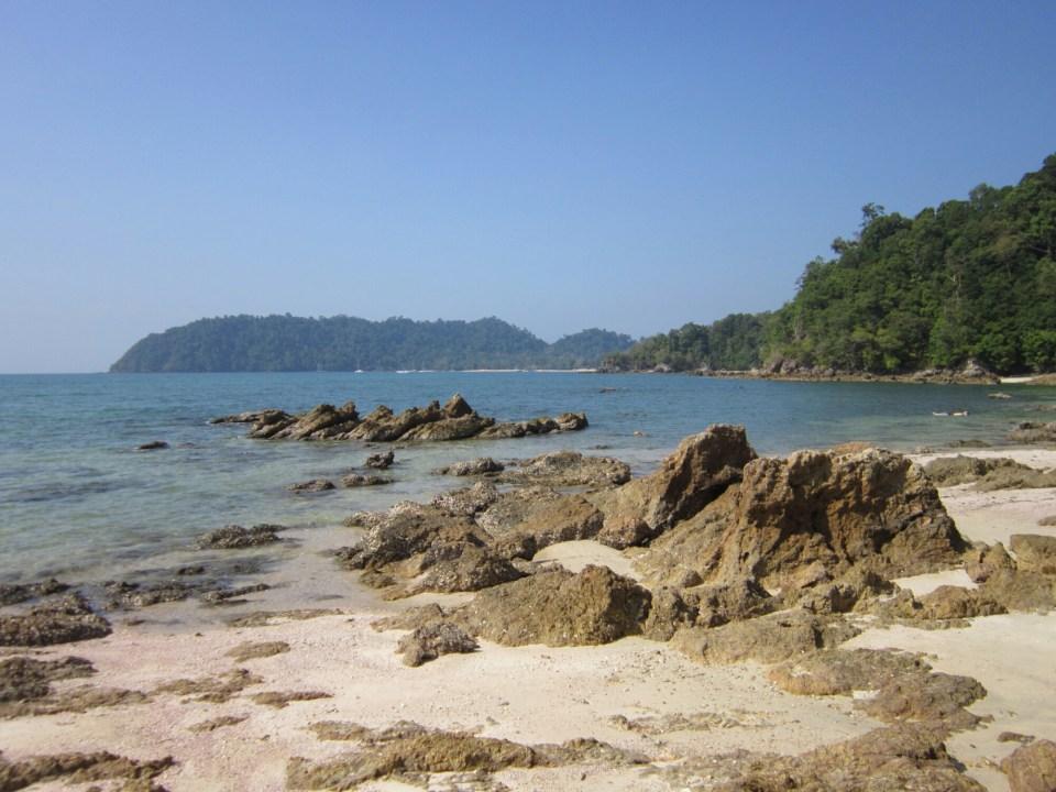 Empty beach with sand and rocks, Koh Phayam, Thailand