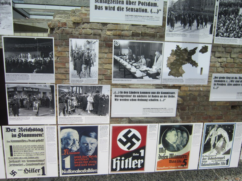 Things to do in Berlin - Topography of Terror posters and pictures displayed on ruins of berlin wall