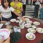 The people of Myanmar - Women giving out free deserts on the streets of Yangon