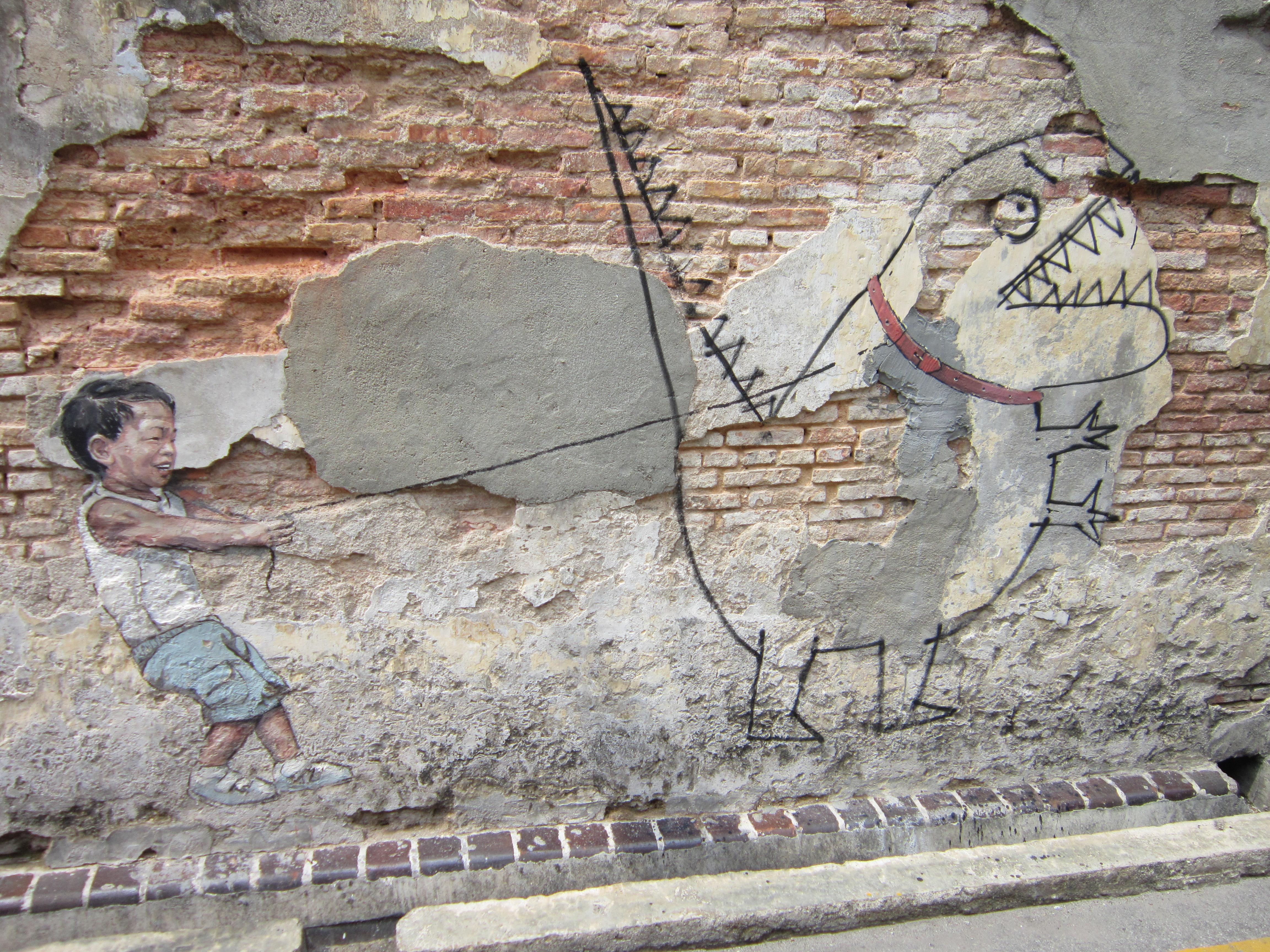Penang Street Art Little Boy with Pet Dinosaur