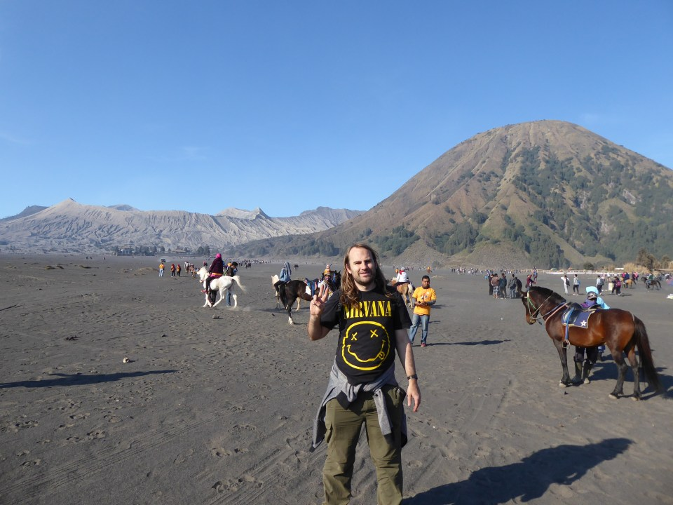 A picture of me in front of the volcano and sea of sand. I'm wearing a Nirvana t-shirt.