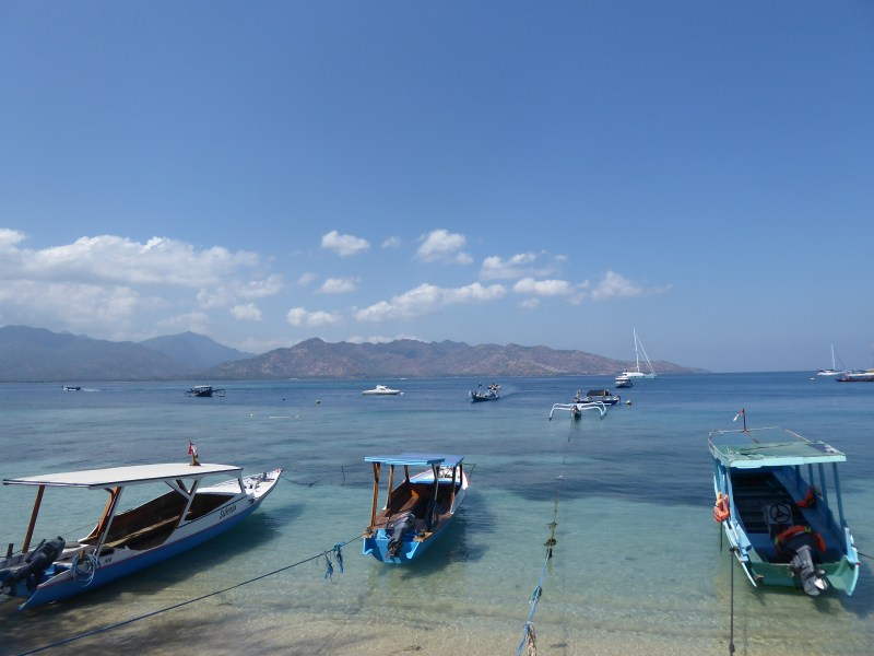 Looking across the water towards Lombok from Gili Air. Shows sea, land and boats