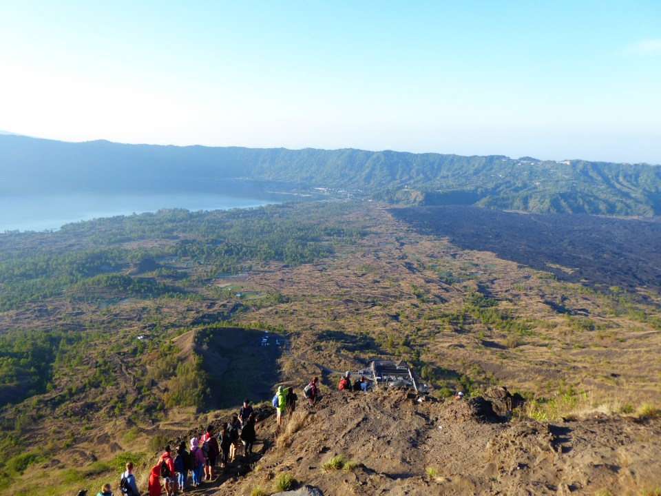 View walking down Mount Batur. Lake Batur on the left. The black lava field on the right.