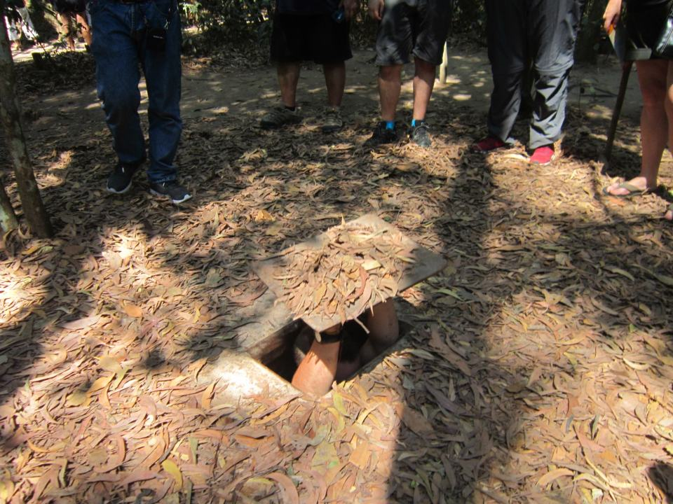 Cu Chi tunnels - hiding hole cover - Vietnam Backpacking Itinerary