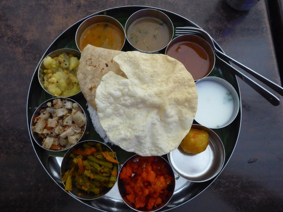 A vegetarian Thali - a good example of an Indian Malaysia Vegetarian meal containing multiple dishes, rice, bread, poppadom