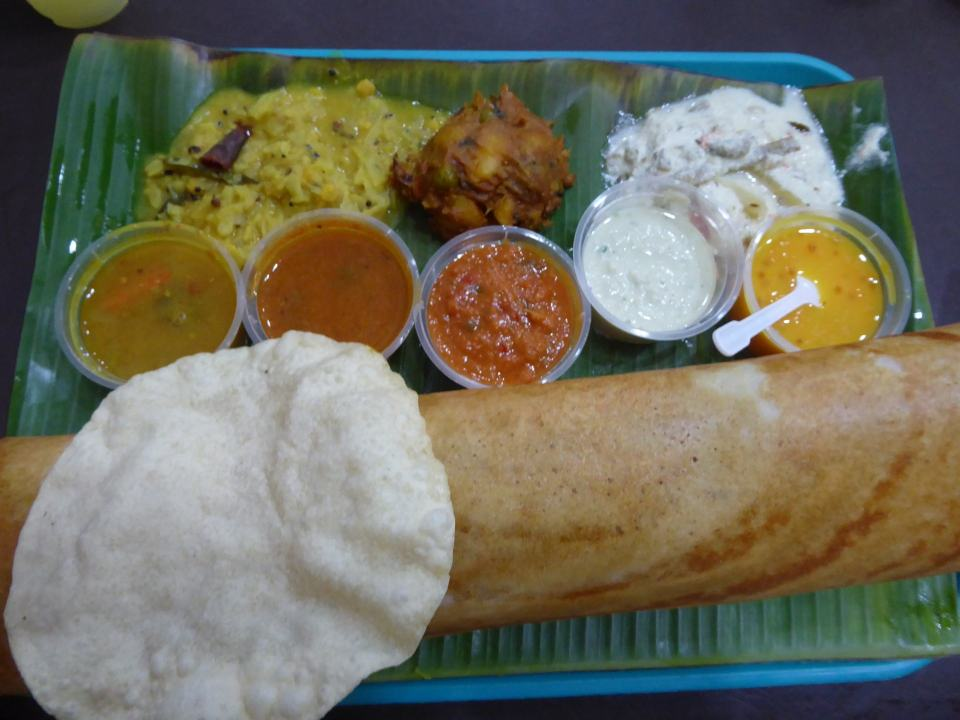 A Dosai meal at Komala Vilas on Serangoon Road. Including a Dosa, poppadom, several curry and dips pots and a bhaji.