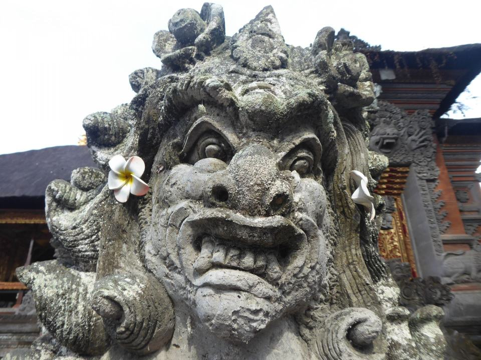 A head of a Balinese Hindu statue. Its a snarling female figure.