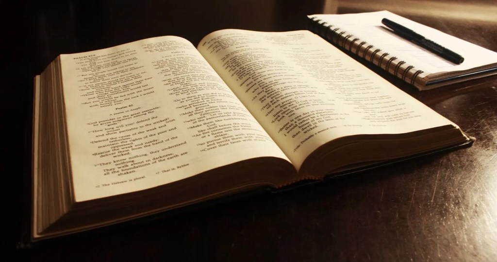 Photo of Bible and Notebook