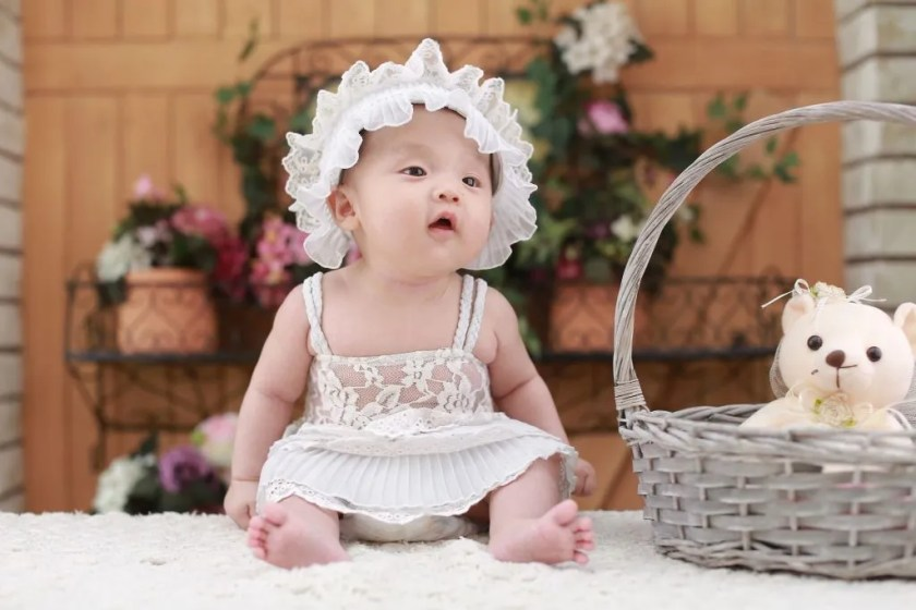 Photo of Baby Sitting on Table Optimized by jpegMini