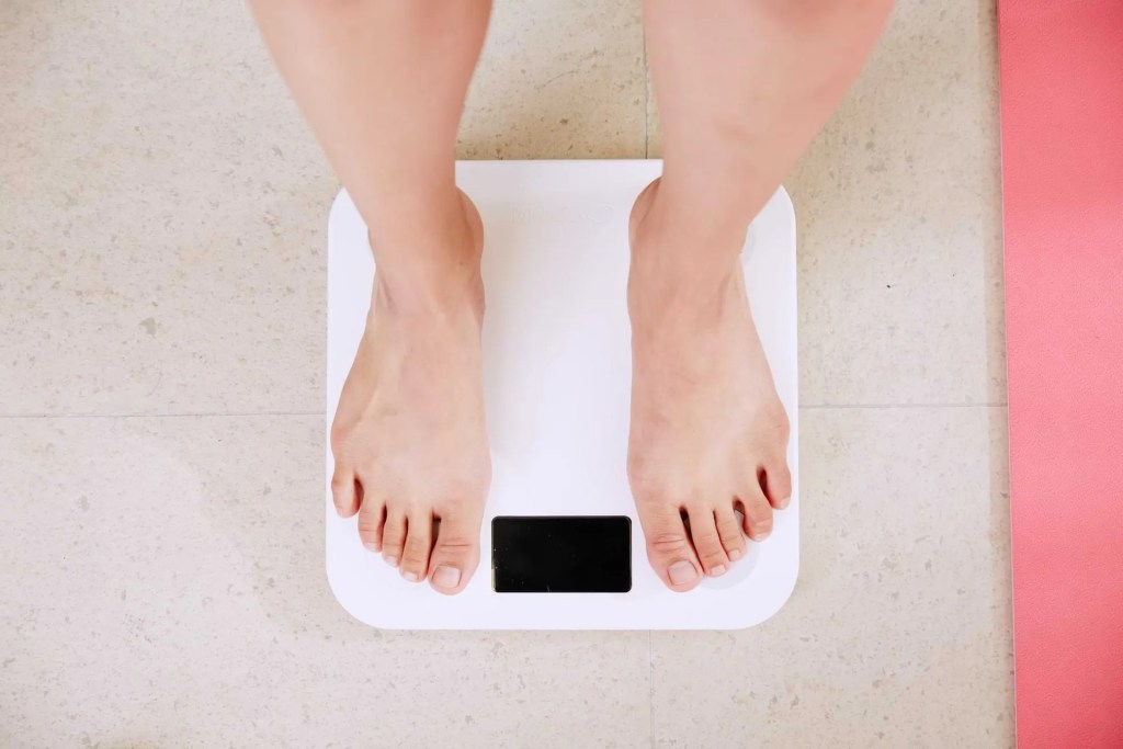 Someone Standing on a Weight Scale