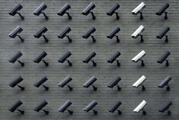 Image of surveillance cameras on a wall, symbolizing a lack of privacy