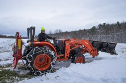 Dick clearing snow for parking