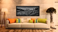 The rock needle in Eskdale, Cumbria. With the snow capped Scafell mountain range in the background - Black oak floater frame with acrylic glazing on Wall