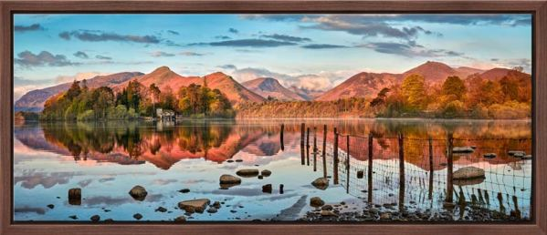 The early dawn sunlight turns the mountains around Derwent Water a lovely shade of pinky red. View from Hope Park