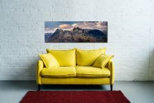 The snowy summits of the Langdale Pike and the dark rock face of Pavey Ark - Print Aluminium Backing With Acrylic Glazing on Wall