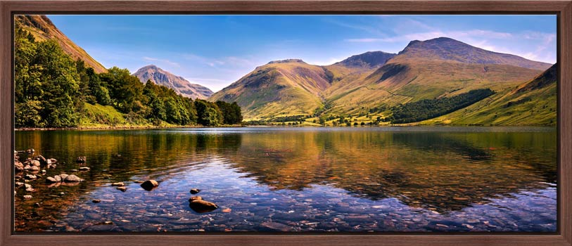 A summer afternoon at Wast Water with Sca Fell reflecting in the calm waters of the lake