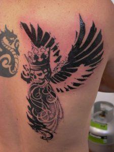 winged skull dot work tattoo tauranga