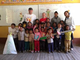 Working with children at Kuska School as part of ParishAbroad trip to Peru with World Leadership School