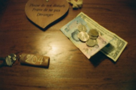 Thai baht (50) and USA dollar (1) and coins (various) - as shown with key (room 204) and Do Not Disturb sign (used)