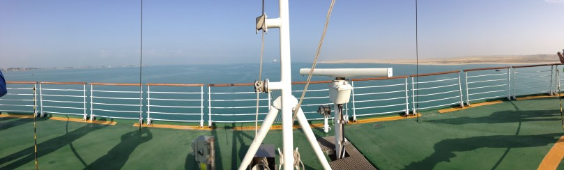Header: Suez canal from ship stern with rigging