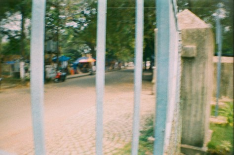 Scenes of Life in Tripunitura & Kochi: fence separating the church yard and cenotaph area from Mahatma Gandhi beach area