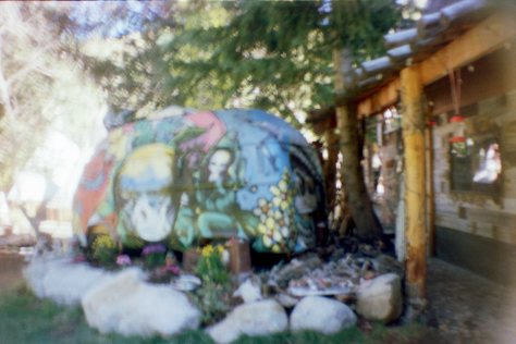 Earthship VW bus/sauna: bus driver's side in flower bed