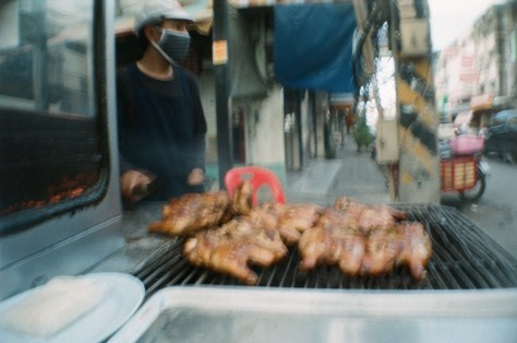 Scenes of Life in Phitsanulok: chicken grilling and griller