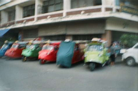 Scenes of Life in Phitsanulok: tuk-tuks wait at train station