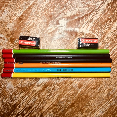 Items: stationery, pencils (various colours) and eraser (2, black)