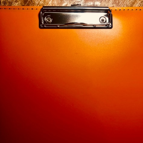 Items: stationery, clipboard (orange, vinyl sewn cover)