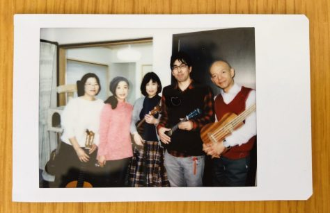 Kazuko-san (plays piano in Mae Maes but guitar in this case), Mitsuko-san (percussion), Sachiko-san (tenor ukulele), Kobayashi-san (soprano ukulele) and Yano-san (bass ukulele)