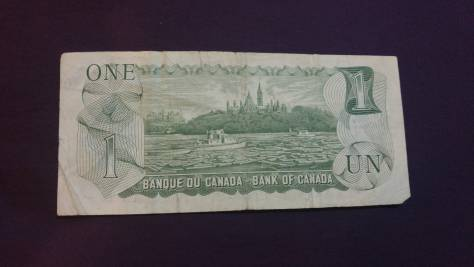 Canada: 1 Dollar (featuring Queen Elizabeth 2 of UK) back – thanks to Pvt. Ben Rees CF