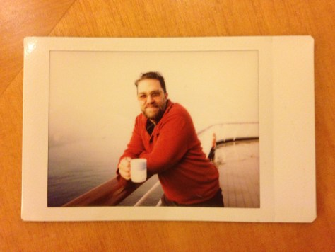 At Sea: Leaning with mug and orange sweater, 4