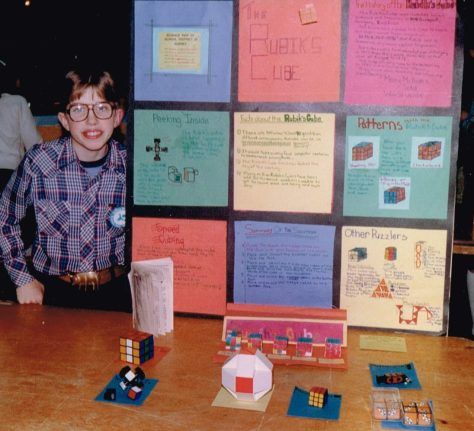 Science Fair: Grade 6, Rubis Cube and other puzzles - note: brass pig belt buckle