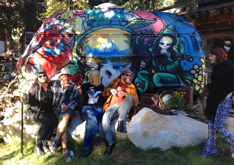 header earthship side with friends