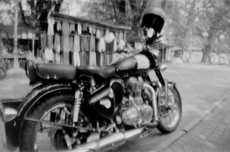 Royal Enfield motorbike near Mahatma Gandhi beach