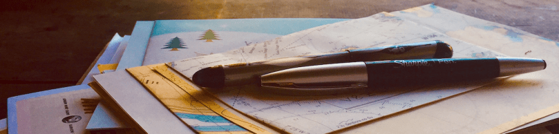 Header: letters and pens on ship